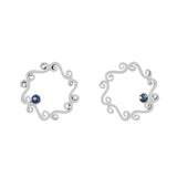 Silver swirly stud earrings with sapphire offset