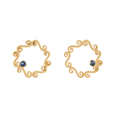 Simple swirly gold stud earrings with round sapphire stone off set