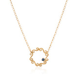 Swirly gold necklace with blue sapphire