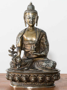 Statues, paintings and photographs of Buddha and Ganesh
