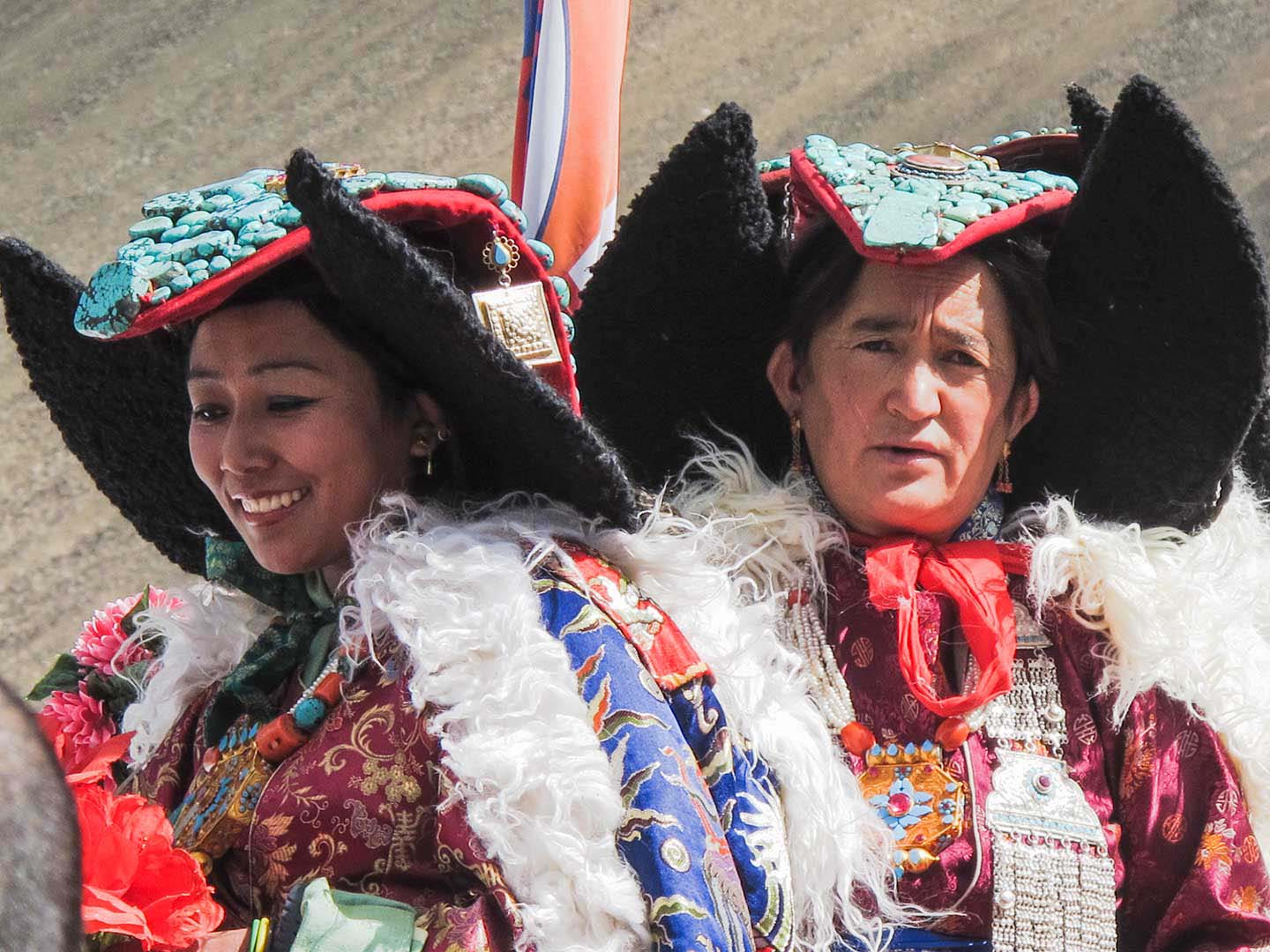 Leh women wearing their coral and turquoise peraks to see the Dalai Lama