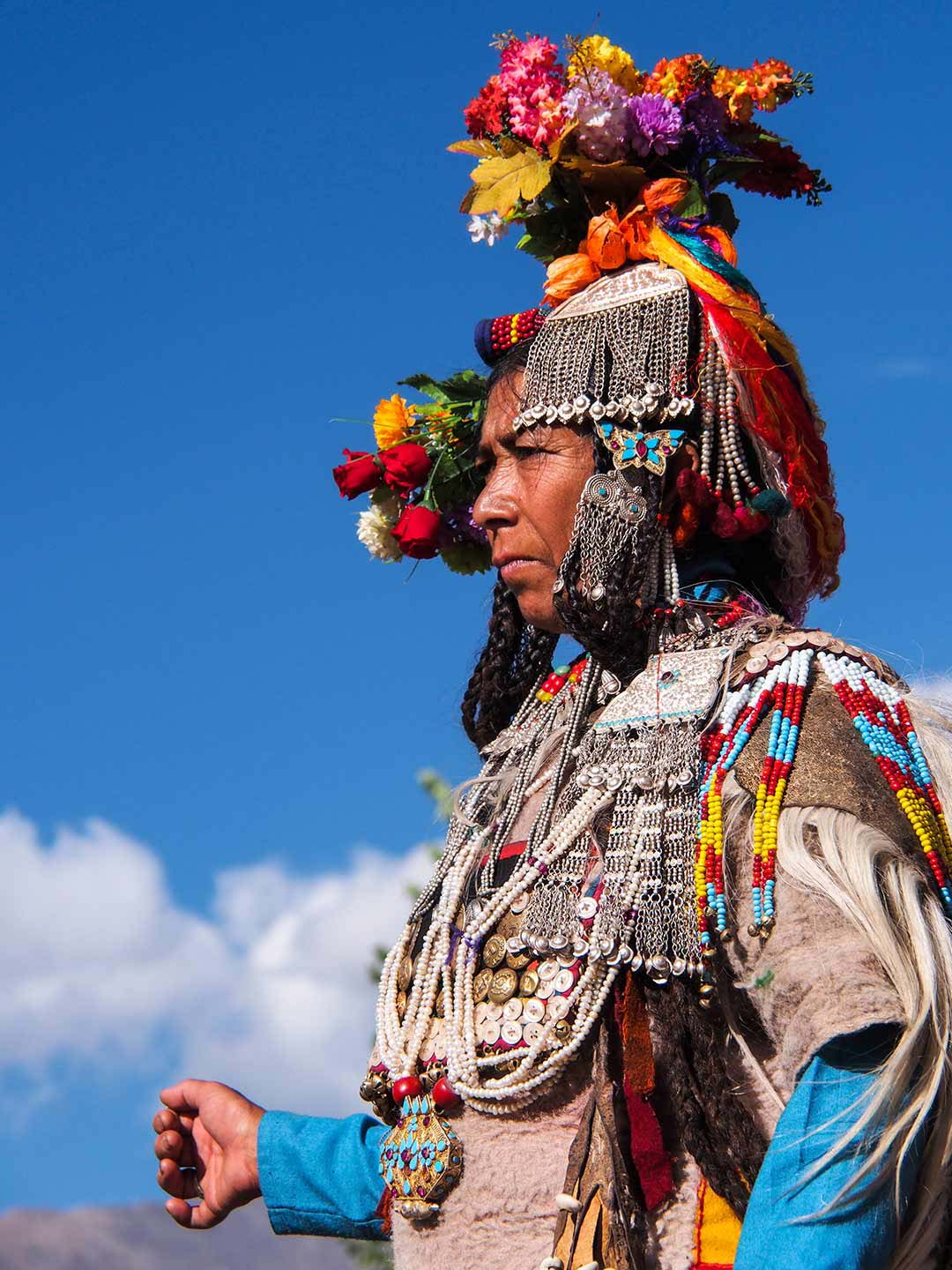 The Dha Hanu people wear elaborate floral headdress
