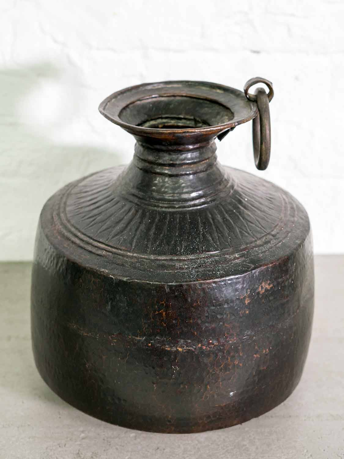 A blackened copper vase that's an everyday water pot from India