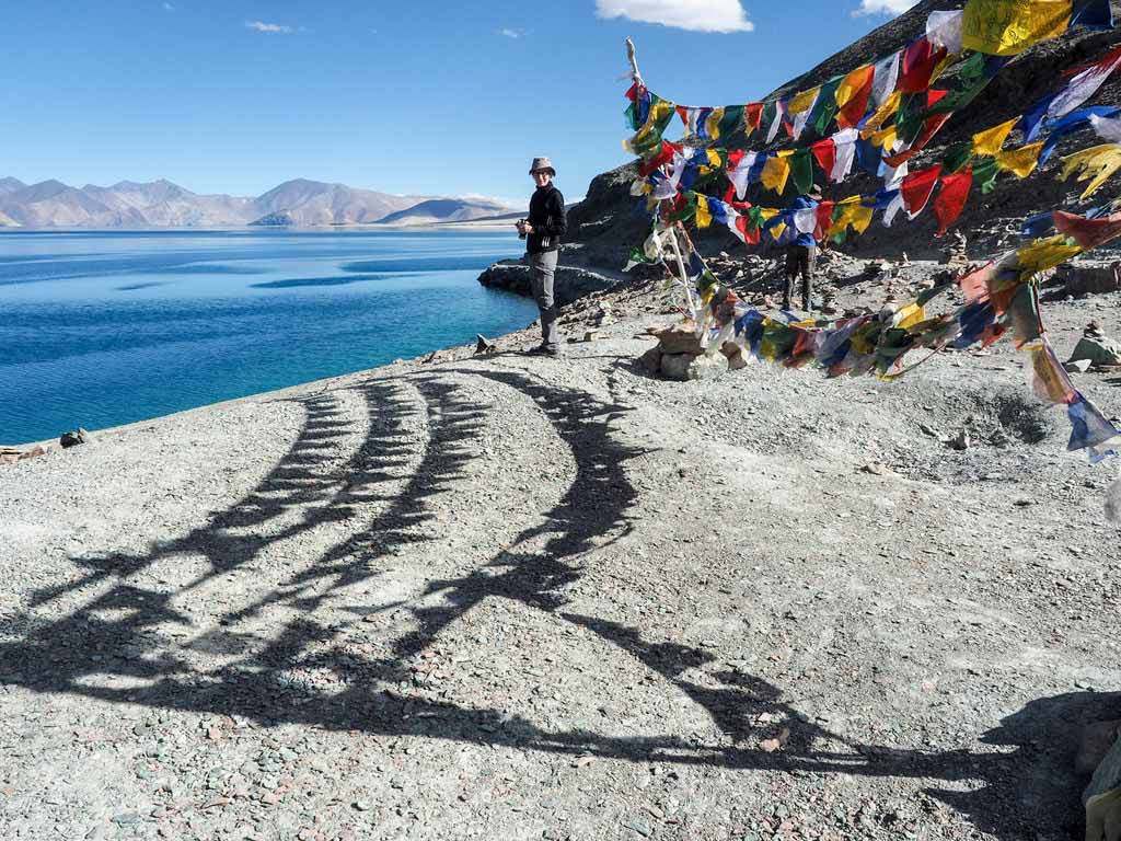 Bev and Prayer Flags at Pangong Tso