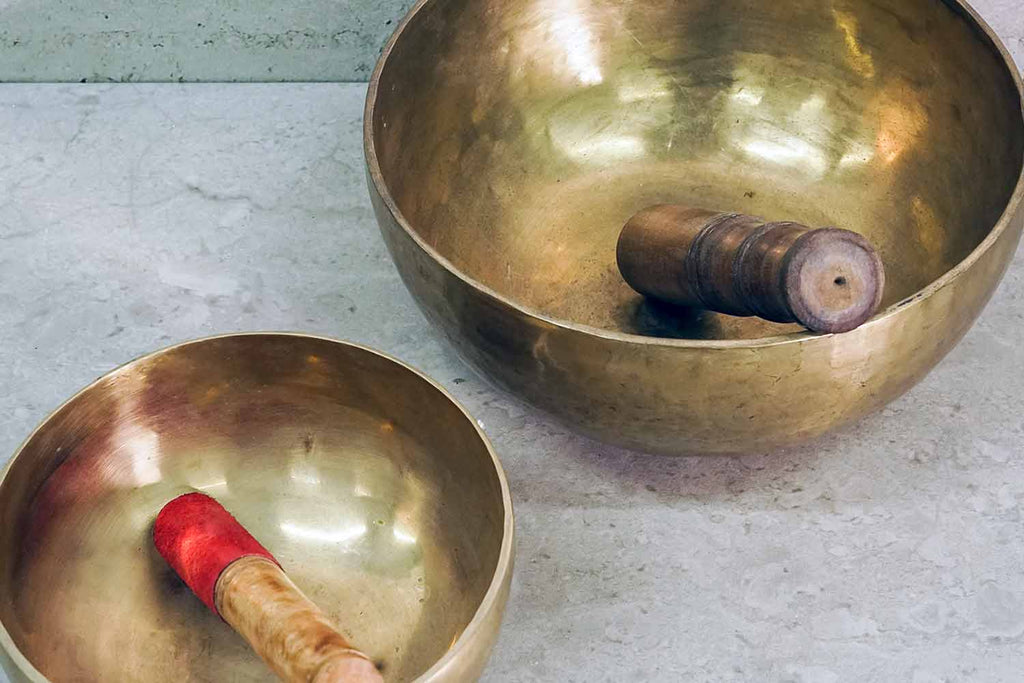 Two Tibetan Singing Bowls with Strikers
