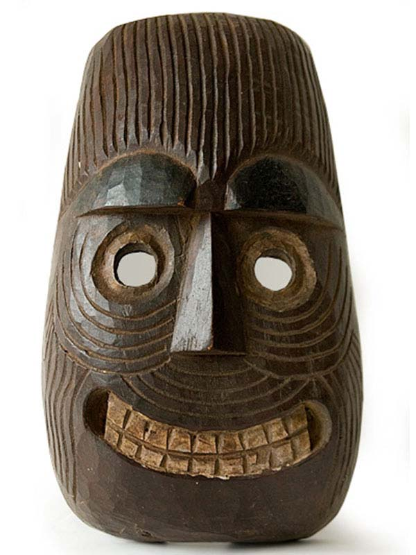 grinning wooden mask