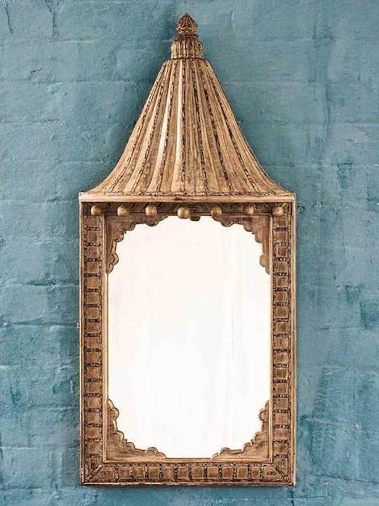 An unusual and very decorative canopied Indian mirror.
