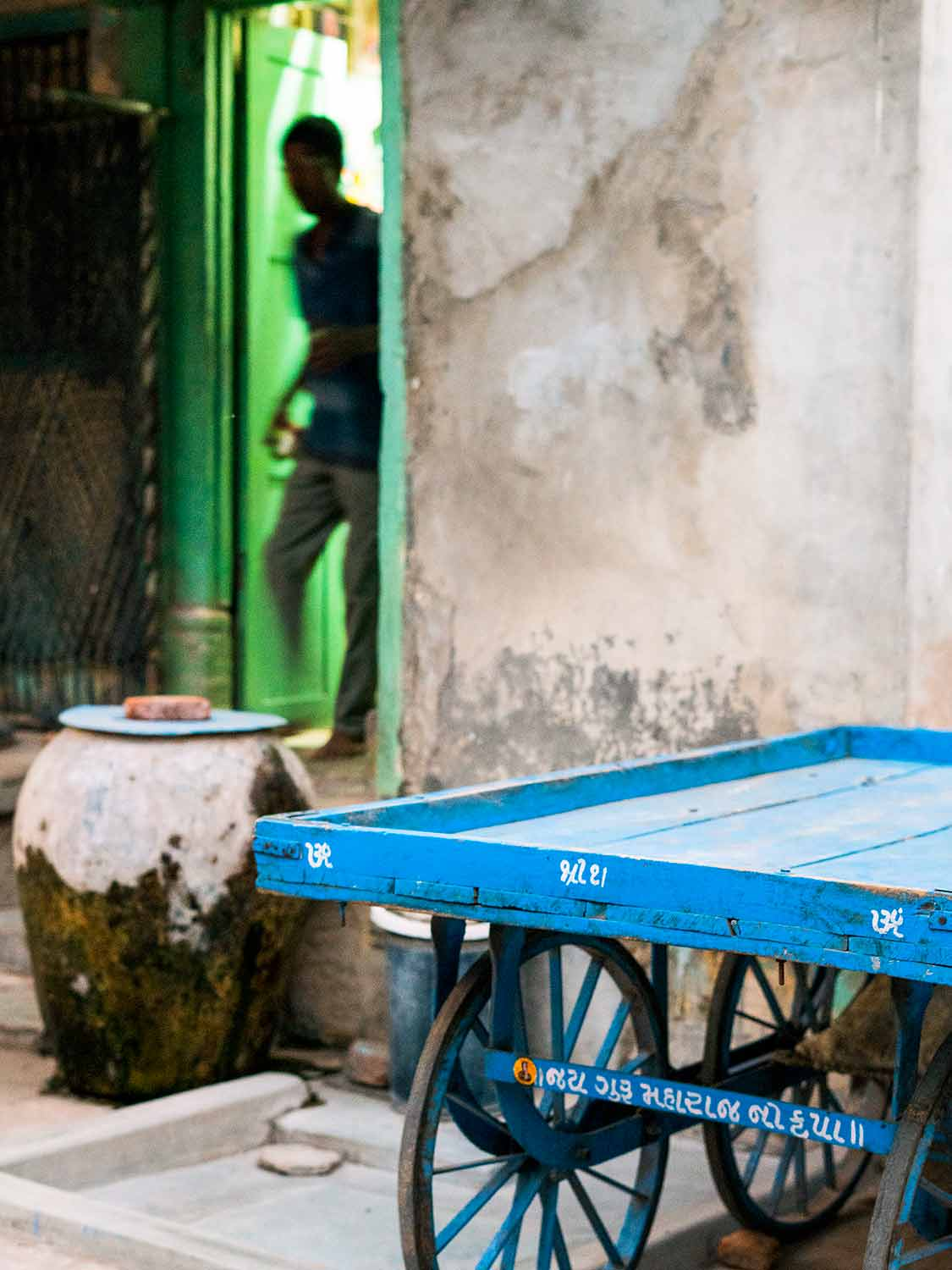 Green Door, Blue Cart, Nighttime in Ahmedabad | Photos of India