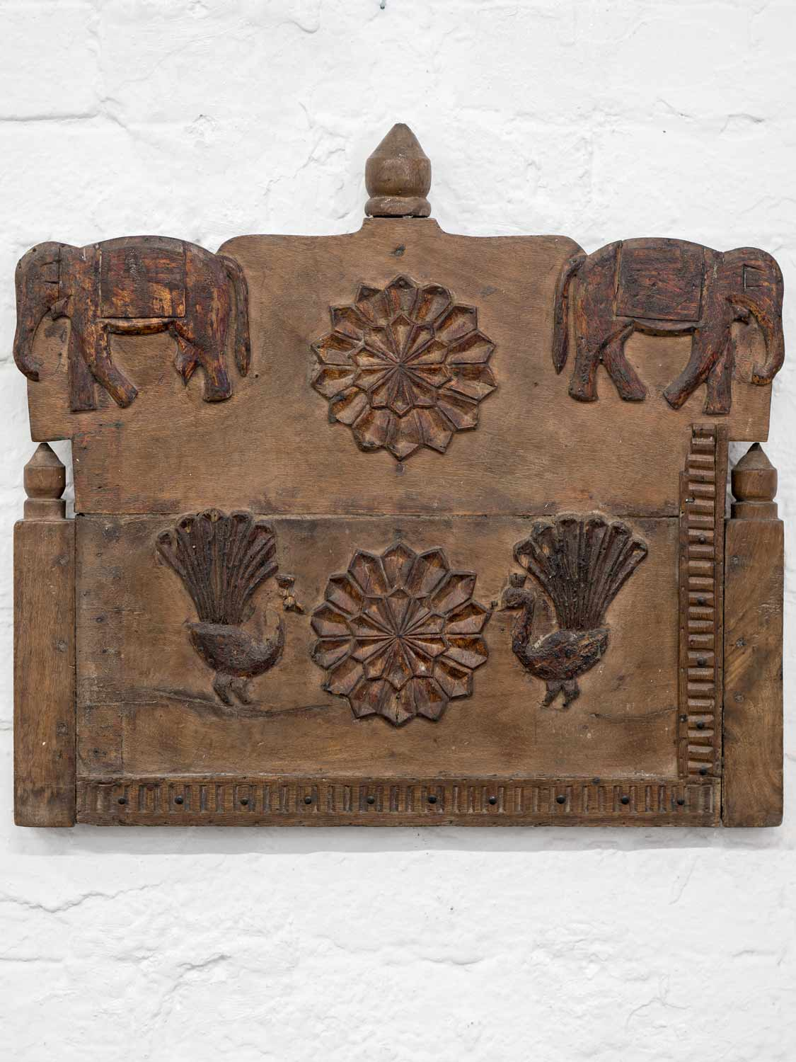 Carved Wooden Panel with Elephants and Peacocks