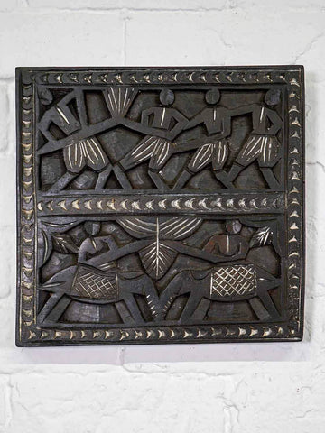 Carved Wooden Panel with Tribal Carvings