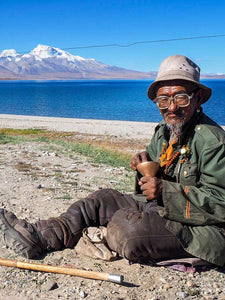 Photo of an old man at Lake Sarovar, Tibet, detail