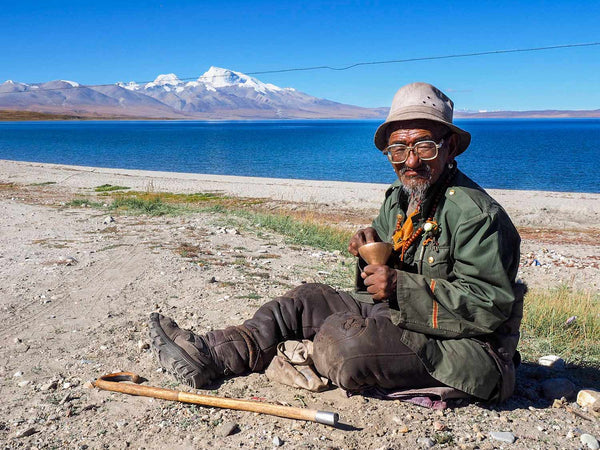 Photo of an old man at Lake Sarovar, Tibet