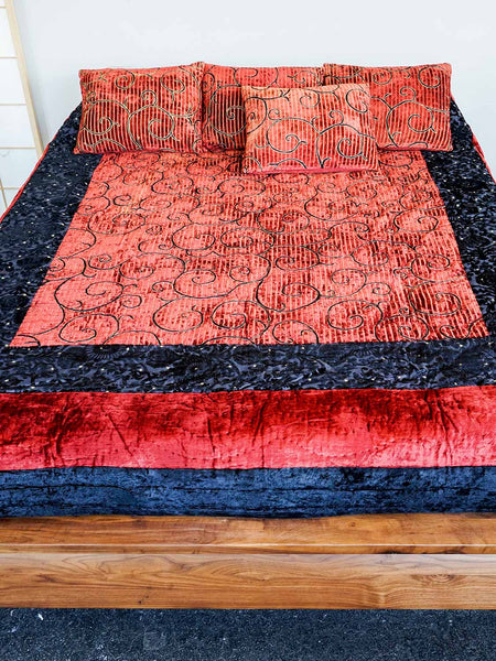 Red and black velvet Turkoman quilt with gold detail