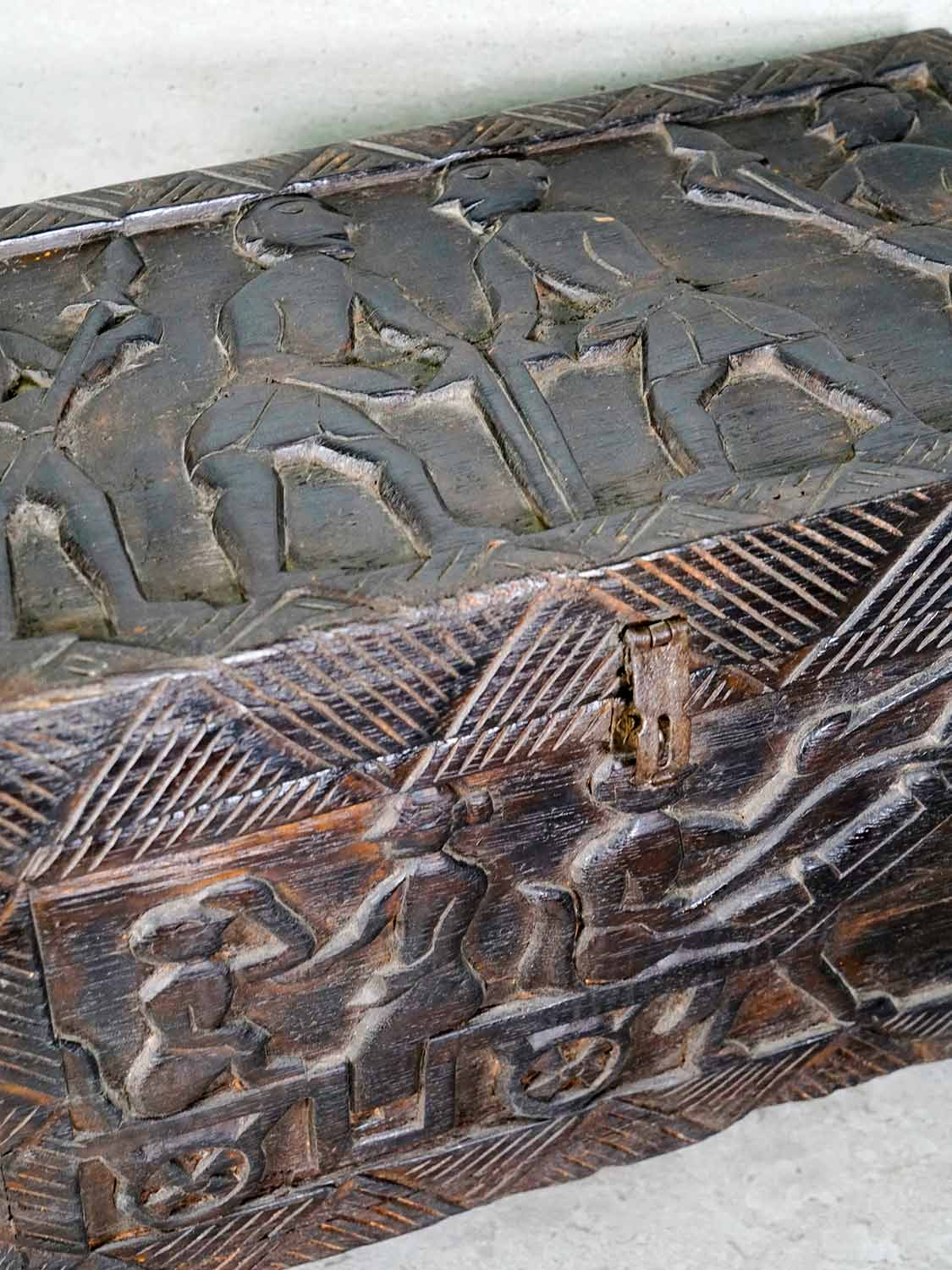 Small wooden Indian chest with tribal carvings