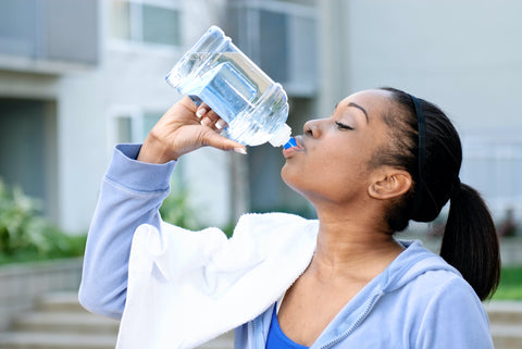 Woman drinking more water to stay hydrated and health for summer