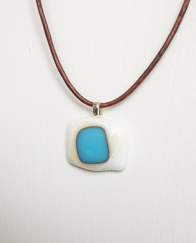 Mod pendant with leather cord