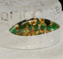 Pod shaped fused glass pendant green amber and black