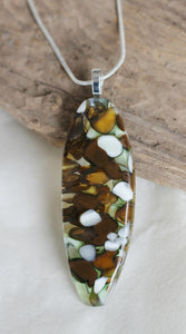 Fused glass pod shaped pendant brown white green