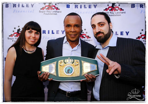 © SARTONK. SARTONK's Director of Operations, Hasmig Tatiossian and President, Ed Majian, with Sugar Ray Leonard. Photo credit: Mikey Williams