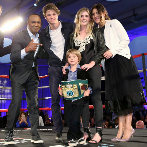 © SARTONK. A SARTONK championship belt is gifted to the late Michael King's family to honor his legacy and contributions to the Sugar Ray Leonard Foundation. Photo credit: Mikey Williams