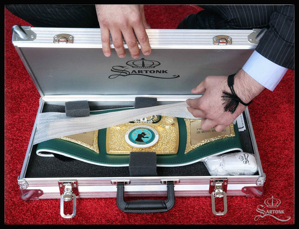 "© SARTONK. A gift from Sugar Ray and Bernadette Leonard to the family of the late Michael King for his contributions to the Sugar Ray Leonard Foundation. The championship boxing belt was made by SARTONK, an official sponsor of the ""Big Fighters, Big Cause"" charity night of boxing. Photo credit: Mikey Williams"