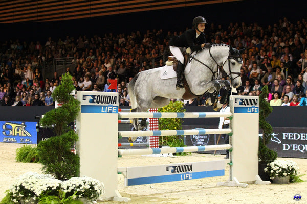 Carly Anthony jumping indoors in Europe