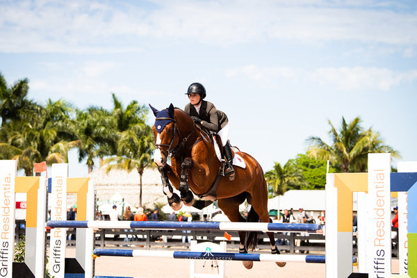 Caitlyn Connors jumping the Griffis Residential Jump in Wellington Florida at the Winter Equestrian Festival