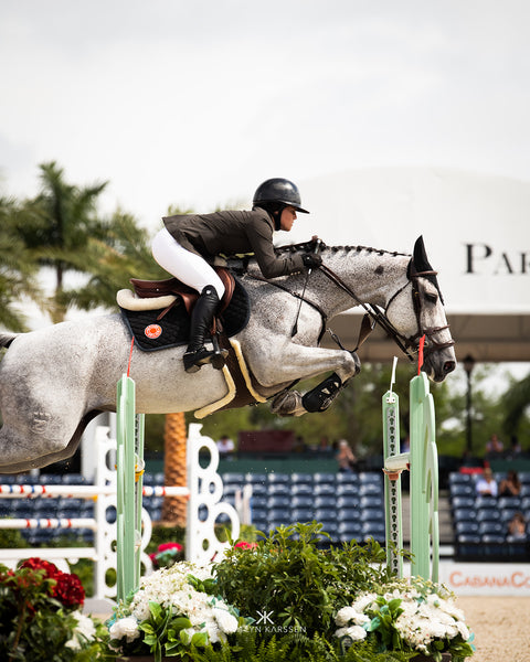 Caitlyn Connors jumping in the International Ring at the Winter Equestrian Festival in Wellington, Florida