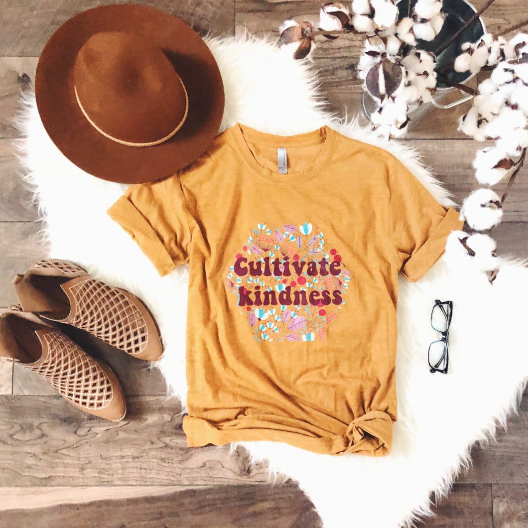 Cultivate Kindness Short sleeve miscellaneous tee Next Level 3600 antique gold S Antique gold