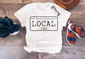 Local license plate state tee- N-O Short sleeve state tee Bella Canvas 3001 natural and deep heather
