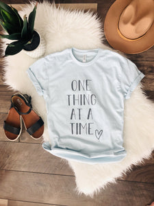 One thing at a time tee Short sleeve miscellaneous tee Bella Canvas 3001 Ice Blue