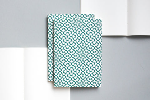 A5 notebook with plain pages and an embossed cover printed in green