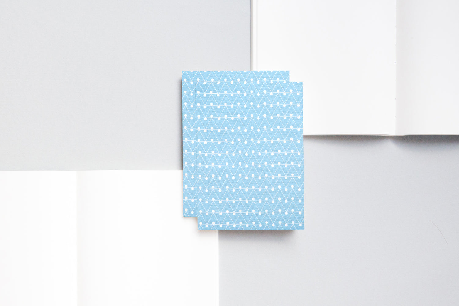 A6 notebook with plain pages and an embossed cover printed in blue