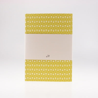 A5 notebook with ruled pages and an embossed cover printed in leaf green