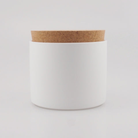 White porcelain jar with cork lid