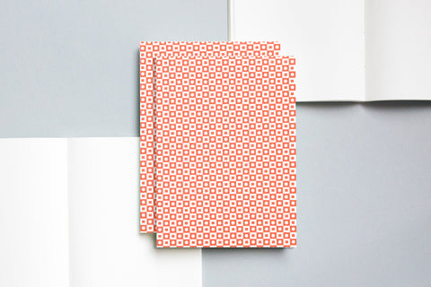 A5 notebook with plain pages and an embossed cover printed in red