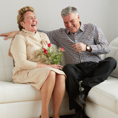 senior men and women on couch wearing adaptive clothes
