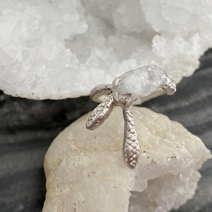Hand carved from wax, this Sterling Silver ring features 2 guardian snakes wrapped around a raw, rough crystal.