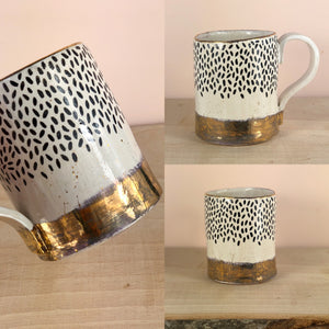 Gold lustre hand painted mug with black fleck pattern
