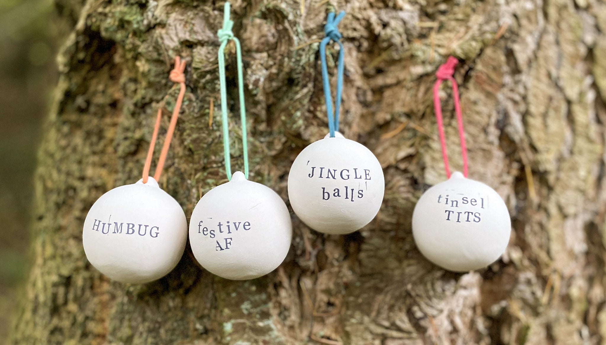 Set of 4 cheeky hand stamped ceramic Christmas baubles