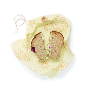Beeswax sandwich wraps include a string and button to secure your favorite sandwiches
