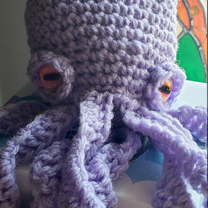 Crochet Octopus Friend Made with Orange Glass Button Eyes