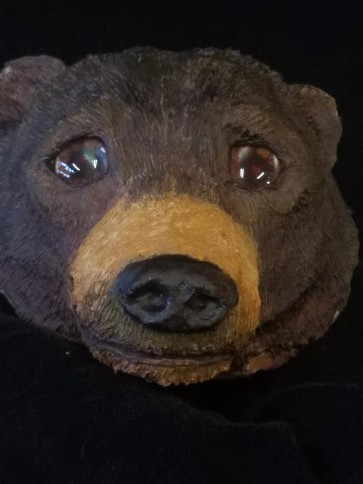 brown bear sculpture with animated glass teddy bear glass eyes