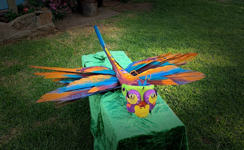 dragonfly sculpture made with glass eyes