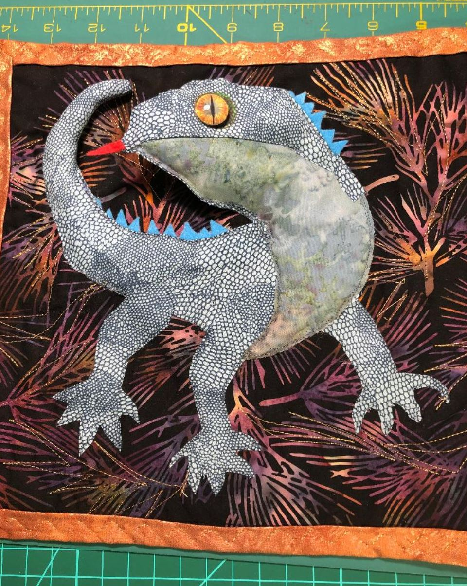 fabric lizard with dragon glass eyes