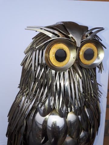 metal owl sculpture with yellow owl glass eyes