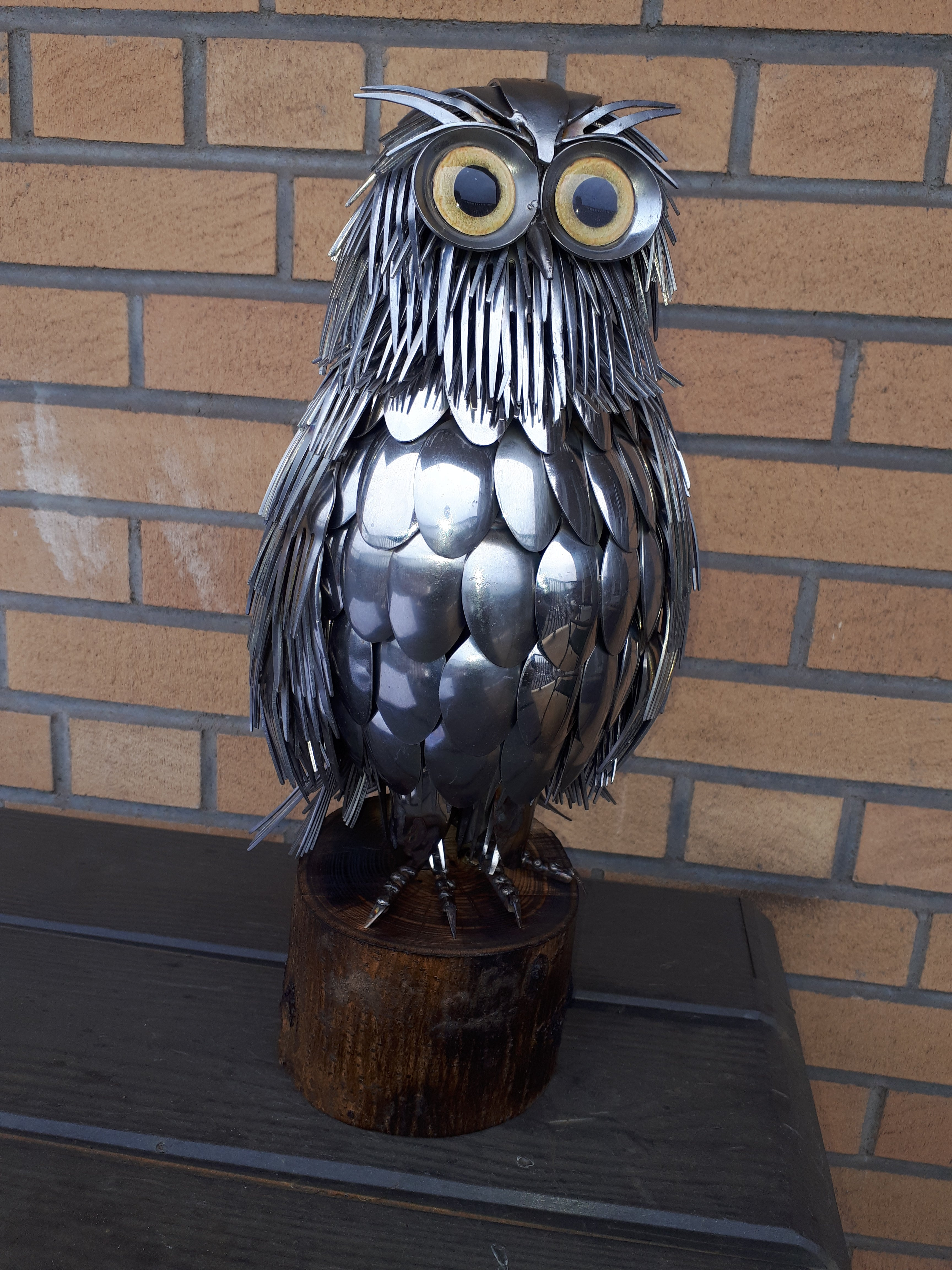 metal cutlery owl sculpture with yellow glass eyes