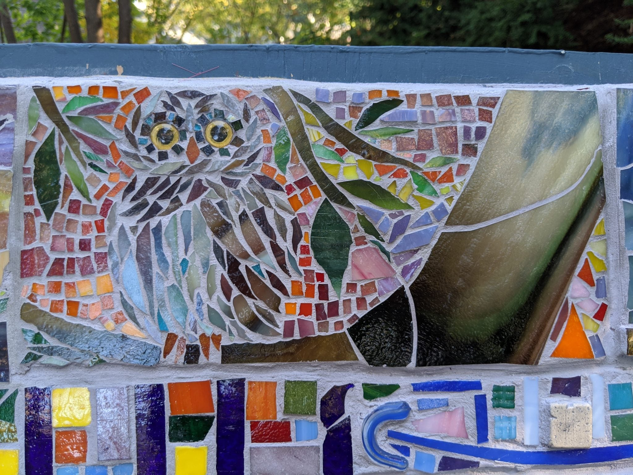 outdoor mosaic owl panel with owl glass eyes in yellow