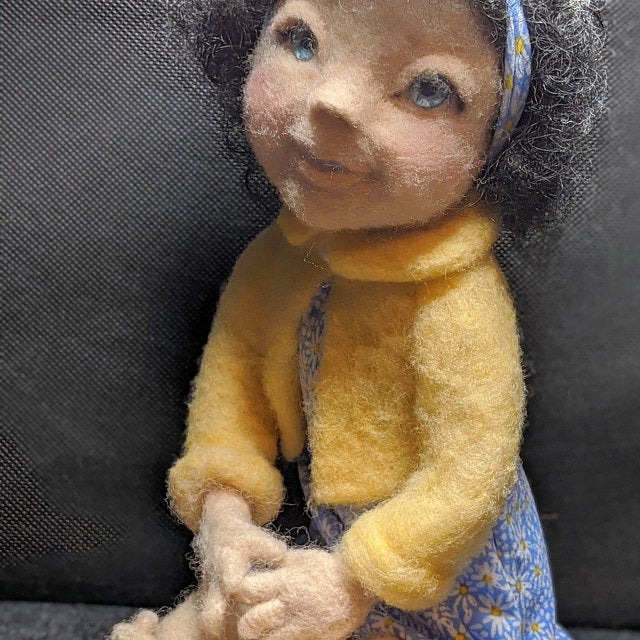 Needle felted doll with blue eyes