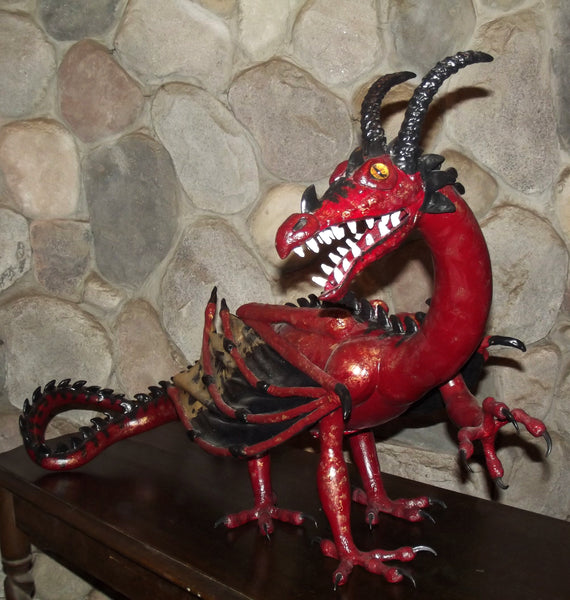 red dragon sculpture with golden eyes